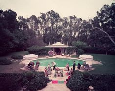 Scone Madame - Slim Aarons: Afternoon tea round the pool on a cold day at the home of interior decorator James Pendleton in Beverly Hills.
