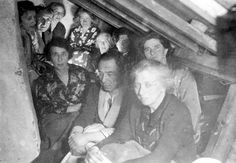 The Netherlands, Jews sitting in a crowded hiding place.