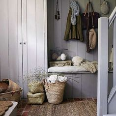 Click on the photo for stylish ways to use woven baskets in a cottage style entryway.  These would work well in other areas too.