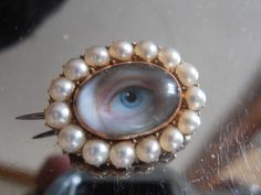 VERY RARE GEORGIAN LOVERS EYE MINIATURE IN A GOLD & PEARL SET BROOCH. Sold for £1,200.00