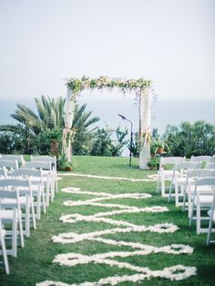 Romantic and white pedal pathway from Isari Flower Studio.