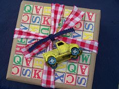 what a cute gift wrapping idea using kraft paper, scrap paper and toy truck...could adapt this idea for many toys
