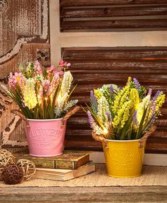 This Lighted Country Floral Arrangement glows with 6 warm, white LED lights. Faux lavender and wildflowers come in a pastel metal bucket that's embossed with th Metal Wall Flowers, Ltd Commodities, Lakeside Collection, White Led Lights, Light Table, Light Decorations, Scented Candles, Framed Wall Art