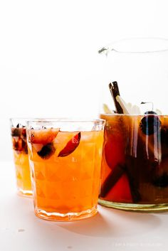easy sparkling sangria: prosecco, simple syrup, aperol, fruit and cinnamon sticks