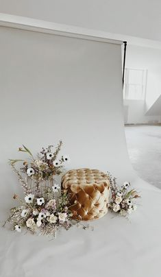 Unique open photo booth idea with flower installation and velvet ottoman - stunning!