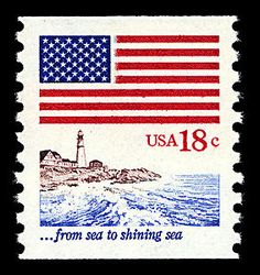 "This stamp, featuring a flag above a Maine lighthouse, was part of series that depicted lyrics from ""America the Beautiful."""