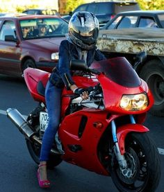 ::Russian motorcyclist... Love the red heels