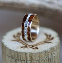 Men's wedding band with ironwood and antler inlays. Handcrafted by Staghead Designs.