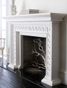 love this mantel!  From Horchow. And great idea to do it DIY with greek key panels from O'verlays