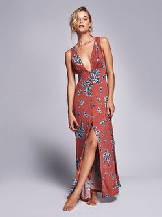 I'm not a fan of the plunging V-neckline but do love how the dress hugs the figure but is flowy at the base.