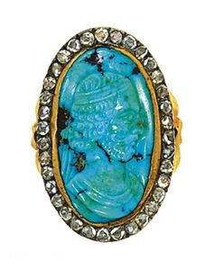 A diamond and turquoise cameo ring   The oval bezel set with a turquoise cameo carved as the head of a Near Eastern potentate in profile facing right, within rose cut diamond border with fretted openwork reverse and foliate shoulders, the cameo circa 1780, the mount 19th century