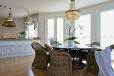 shiny chandelier, bead chandelier, wicker chairs mixed with lucite. Have to study this more to see if this works for me.