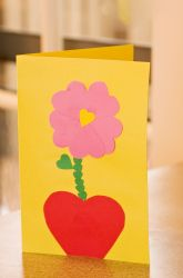 Help your child craft a sweet personalized card this Valentine's Day. Using a heart template, she'll create a lovely flower for the front of the card, made entirely of hearts. This homemade gift—crafted with love—is sure to capture a smile from a very special someone on February 14.