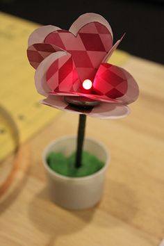 A simple paper flower with LED center. This single flower can be duplicated to make a whole bouquet of LED flowers!