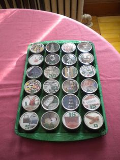 Tin Advent Calendar - use spice jars on a cookie sheet or use small baby food jars