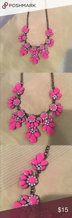 Pink and crystal statement necklace. Cute pink and crystal floral statement necklace. Pewter color chain. Lobster clasp. Adjustable. Jewelry Necklaces