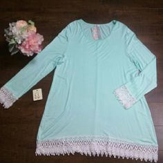 Mint Crochet Tunic Solid mint tuni  with a round neck, long sleeves and a Crochet trim on the hem and sleeves.  95% Rayon, 5% Spandex Tops Tunics
