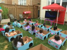 Outdoor Drive Inn Movie Party.- cars made from boxes with paper plate wheels #outdoorpartyactivities