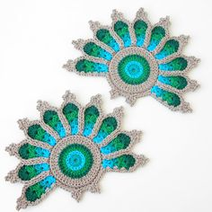 Items similar to Crochet Peacock Tail Feather Coaster in Peacock Green and Blue - Original to The Curio Crafts Room on Etsy Peacock Tail, Crochet Accessories, Ribbon Embroidery, Crochet Motif, Elsa, Coasters, Crochet Earrings, Feather, Etsy Seller