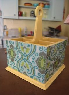 A Mod Podge silverware holder. Great idea! I have the wooden drawer silverware holders, I should Decoupage those too!!