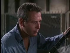 """When Luke gets the news that his mother has died - Paul Newman singing """"Plastic Jesus"""" in Cool Hand Luke."""