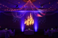 Set apart your sweetheart table with a light-up tulle canopy and castle gobo #wedding #Disney #gobo