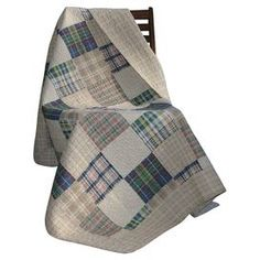 """Perfectly folded at the foot of your bed or draped across your living room chaise, this cotton throw showcases a patchwork motif and earth tone palette.    Product: ThrowConstruction Material: CottonColor: MultiFeatures: Moisture wickingReverses to a neutral plaid backPre-shrunk Dimensions: 50"""" x 60"""" Cleaning and Care: Machine washable. Tumble dry."""