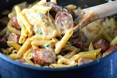 One (Instant) Pot Penne Pasta  - smoked sausage - 2 cloves garlic - mushrooms - 1/2 lb penne pasta - broth - 1 jar roasted red peppers - monterey jack cheese - parmesan cheese - spinach
