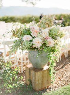 Summery florals: http://www.stylemepretty.com/california-weddings/napa-valley/2016/01/07/summer-al-fresco-wedding-in-napa-valley/   Photography: KT Merry - http://www.ktmerry.com/
