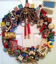Antique Toy Baby Wreath - going to make something similar with kids old toys - fun to hang on the door to their room at Christmas