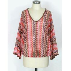 "Anthropologie Sanctuary Nina Poncho top Sz S. Nina Poncho top by Sanctuary from Anthropologie. Oversized,  boxy fit. Big dolman sleeves. Semi-sheer. Tassels in front. Hippie/Boho/Festival feel.  Polyester. Like new condition, no flaws. Approx measurements Length 24.5"". Sanctuary Tops Blouses"