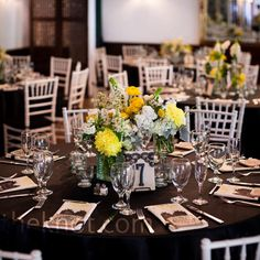 Black tablecloth, yellow, white and green centerpieces