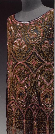 1926 fully beaded evening dress, gold lined beads and pink sequins on black net.