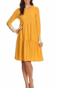 A tiered dress with an empire waistline featuring a crochet trim on long sleeve with a super soft-knit fabric.   Tiered Crochet Sleeve Dress by Chris & Carol. Clothing - Dresses - Casual Clothing - Dresses - Long Sleeve California