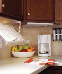 Try a Retractable Book Stand   As these photos show, what makes a kitchen great is how you organize it.