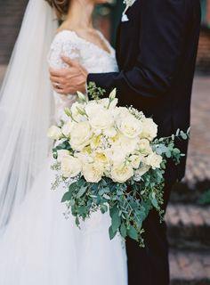 Ivory garden roses and seeded eucalyptus wedding bouquet: http://www.stylemepretty.com/california-weddings/grass-valley/2016/09/15/romantic-outdoor-state-park-wedding-in-california/ Photography: Graham Terhune - http://grahamterhune.com/
