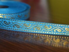 """Beautiful Blue Color hand-loom border from India, Jacquard ribbon border trim. Trim is decorated with golden metallic thread embroidery.   ➤ This listing is sold by (8 yard) Width: 0.5 """"..."""