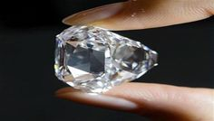 A 76-carat flawless diamond from India's famous Golconda mines broke world record by fetching a whopping 16.9 million Euros at an auction in Geneva. The cushion shaped diamond of perfect D colour from the ancient mines, where the famous Koh-i-Noor and Blue Hope diamond originated, fetched a record price at an auction late last night, Guardian reported quoting an announcement by the Christie's.