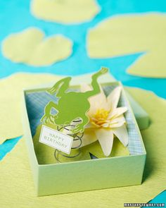 Three dimensional frog in a box card. Would be cute for kid party invites!