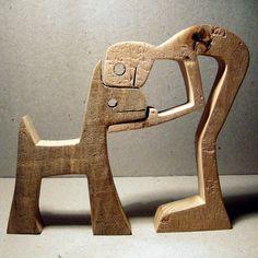 Scultura legno smerlato un uomo un cane
