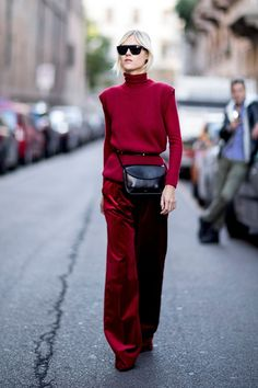 Styling red wide legged trousers and a red turtleneck