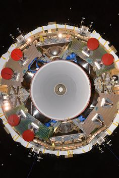 An unusual view of a spacecraft – looking from below, directly into the thruster nozzles. This is a test version of ESA's service module for NASA's Orion spacecraft that will send astronauts further into space than ever before.