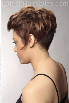 Asymmetrical Shiny  Pixie Cut Side View - this asymmetrical hairstyle definitely has a sharp contrast between hard and soft. The super shiny locks are curled and wavy while the sides and back are buzzed! This is definitely a daring cut worth trying.