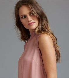 This sleeveless mock neck top is sure to turn heads from desk to dawn. Leather Mini Skirts, Mock Neck, High Neck Dress, Fancy, Casual, Fabric, Model, How To Wear, Clothes