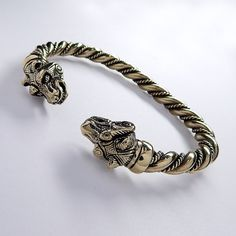 Attention! If the options dont have your Wrist size, write it in the order comments! A massive bronze bear heads viking bracelet, inspired by a find from
