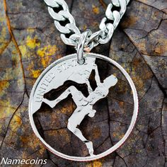 This unique necklace is for any hard core rock climber. It has been cut by hand in this extreme pose. Our cut coin jewelry is very strong and lasts