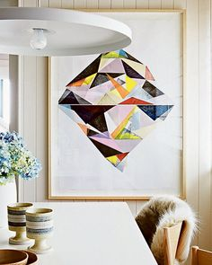 The Melbourne home of Simone and Rhys Haag. Disc pendant light by Toss B, print by Ellie Malin Modern Times