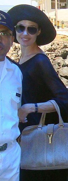 Who made Angelina Jolie's tan tote handbag? Purse – Yves Saint Laurent