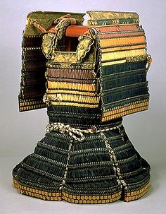 Domaru Armor Laced   with Black Leather Thongs and Purple Red and White Cords. This armor is composed of alternately arranged black-lacquered leather and iron kozane scales. The upper part of the body and the shoulders are laced with purple, red, and white cords, and the lower part is laced with black leather thongs.