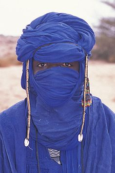 The men of the Tuareg people in North Africa wear a blue turban called a tagelmust, which protects them from the sun and wind-blown sand of the Sahara desert